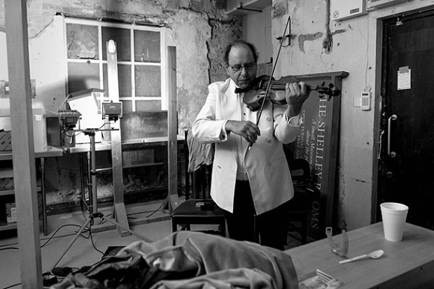 ©Neil Turner, September 2013. Violinist Jack Maguire warming up in his makeshift dressing room