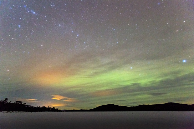 ©Neil Turner February 2014. Low level Aurora activity over a frozen lake, Inari County, Finland