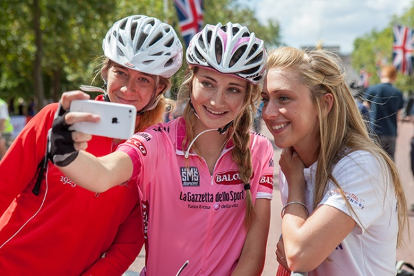 Olympic and Commonwealth Gold medallist Laura Trott posing with riders on The Mall in a break between media interviews during the Freecycle event - part of Prudential RideLondon. 9th August 2014.