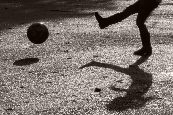 ©Neil Turner, November 2014. Playing football in the  park.