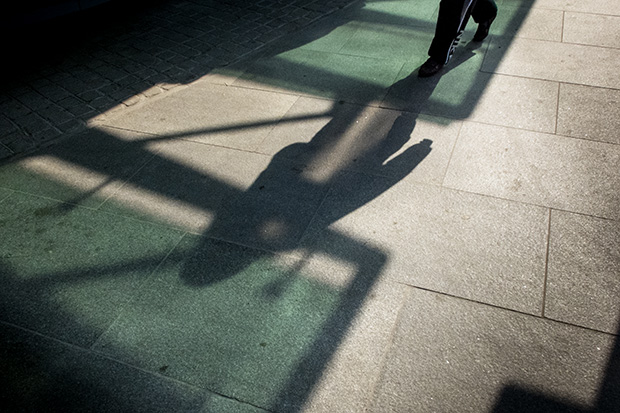 © Neil Turner, March 2014. Shadows on the pavement as a pedestrian passes along Tottenham Court Road.