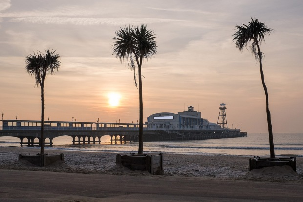 ©Neil Turner, January 2015. Early morning watery sunshine on the beach at Bournemouth.