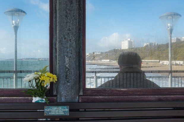 ©Neil Turner, January 2015. Flowers and a memorial plaque to four local surfers on Boscombe Pier.