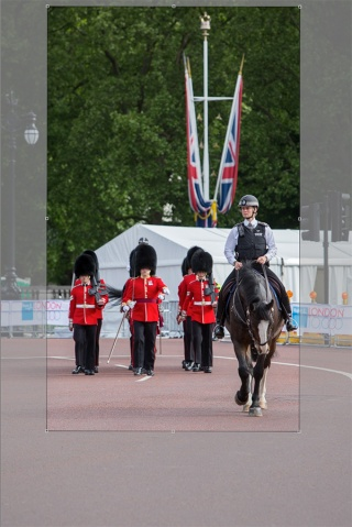 ©Neil Turner/Bupa 10,000. May 2015. A Police rider accompanies a detachments of Guards as they march back their barracks.