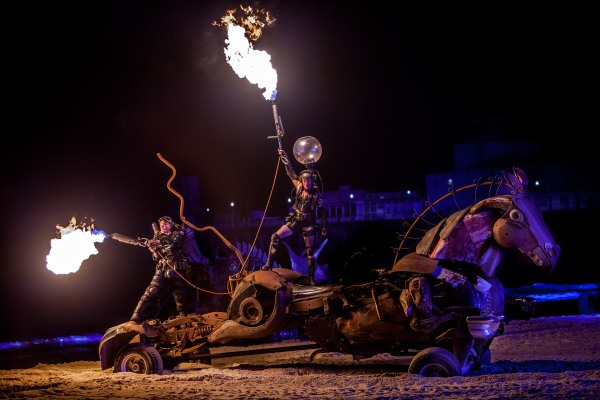 © Neil Turner. Joe Rush and the Mutoid Waste Company stage a spectacular demonstration of their vehicles on the beach next to Bournemouth Pier.