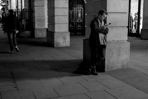 Waiting for people and texting their friends outside the Apple Store, Covent Garden.
