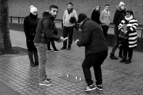 Trying to interest tourists in the shell game on the South Bank in London. © Neil Turner, December 2015